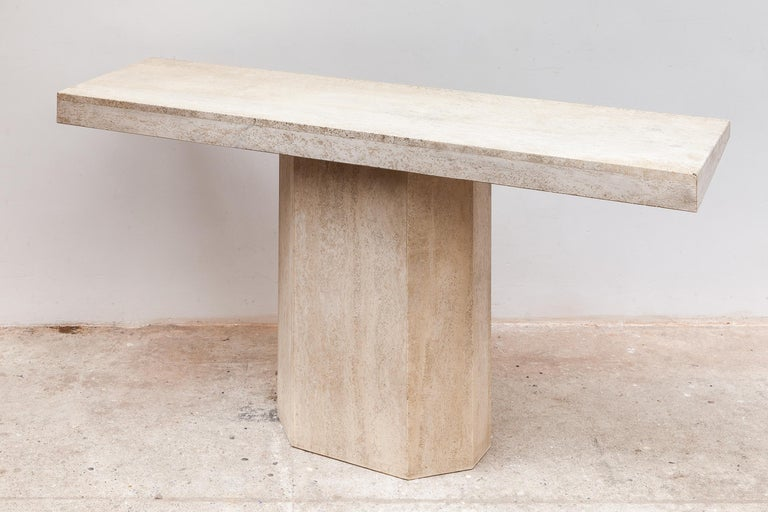 1970s travertine console or hall table. Warm beige color stone with faceted base. Dimensions: 140 W x 66 H x 40 D cm.