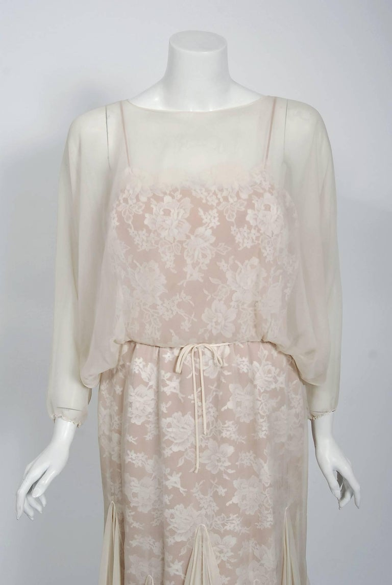 Extremely chic late 1970's ivory silk-chiffon and rose-print lace dress from the iconic Travilla label. William Travilla designed costumes for films and also opened his own salon with best friend Bill Sarris. The designs in his collection became