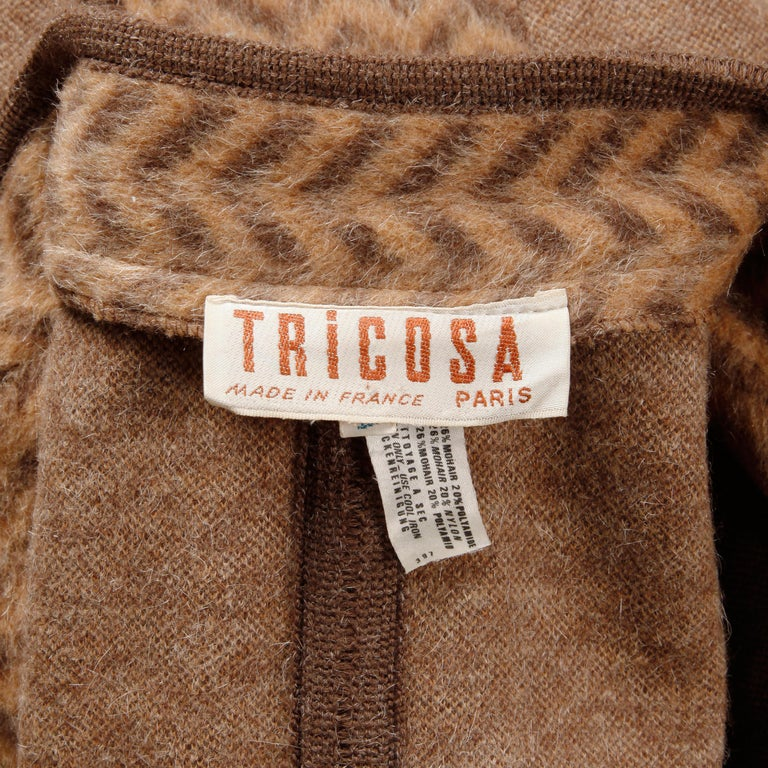 Gorgeous vintage wool blend cape coat with a striped zig zag design and bat wing sleeves by Tricosa. Unlined with front button closure. Front patch pockets. 54% wool, 26% mohair, 20% nylon. Free size. Total length measures 50