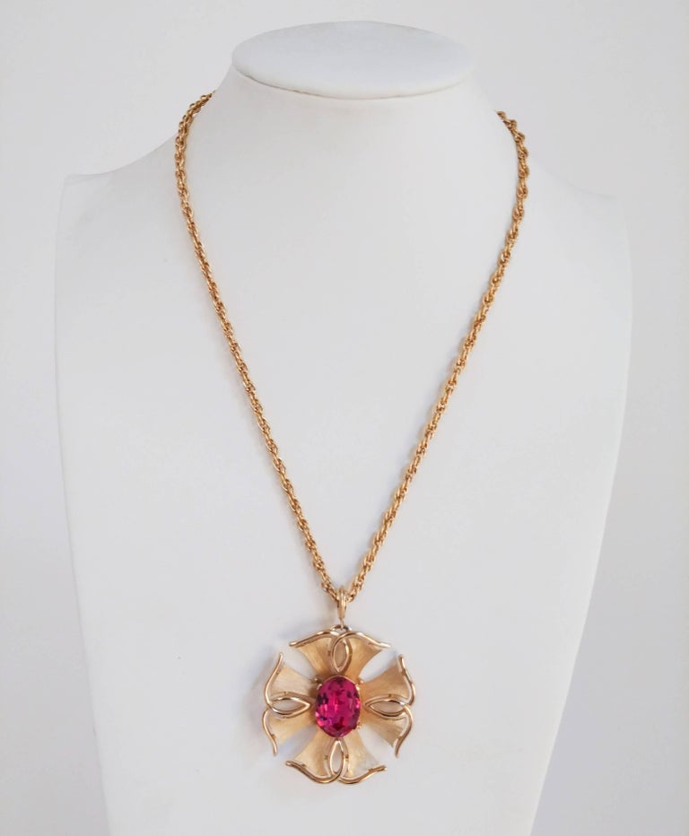 1970s Trierai Magenta & Gold Pendant & Earring Set. Gold-toned jewelry set with large glass stones. Clip-on earrings.
