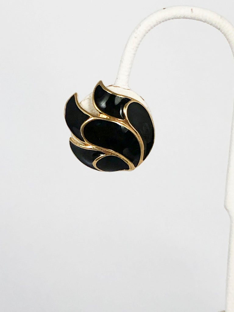 1970s black enamel clip-on earrings set in a gold-washed metal