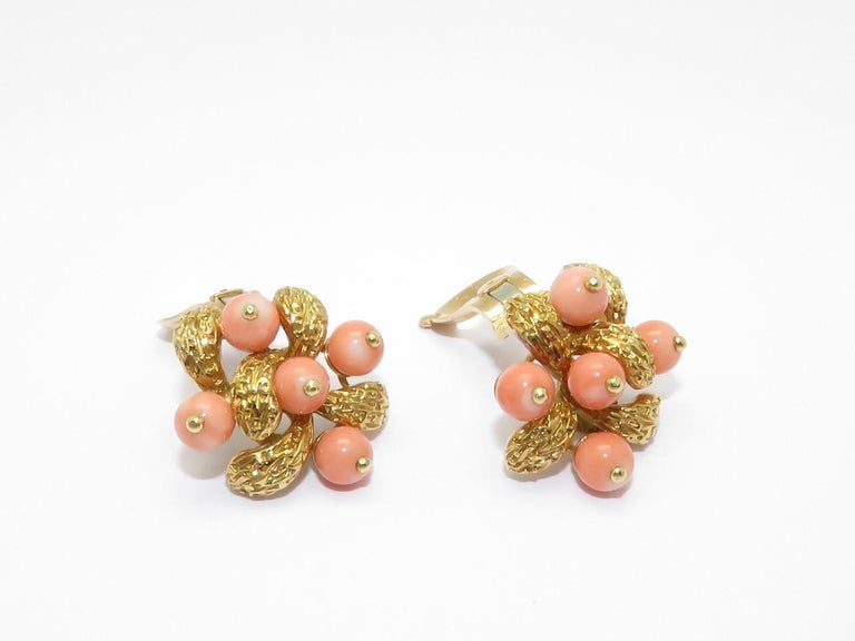 A pair of coral beads and yellow gold earrings. Signed V.C.A and numbered French Mark Circa 1970