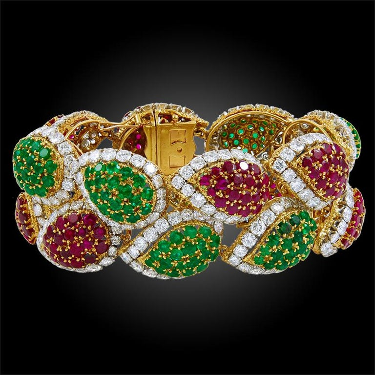 A divine bracelet by Van Cleef & Arpels, designed as foliate motifs made up of vibrant rubies and emeralds of impeccable quality, crafted in 18k yellow gold and platinum. Signed Van Cleef & Arpels.