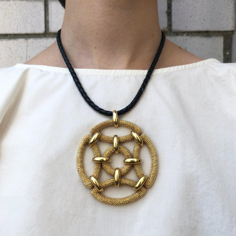 A large 18 karat gold articulated pendant, by Van Cleef and Arpels, 1970s.   Signed VCA © 71. Stamped 750, French Assay Marks. Numbered.   Pendant is sold separately of cord.
