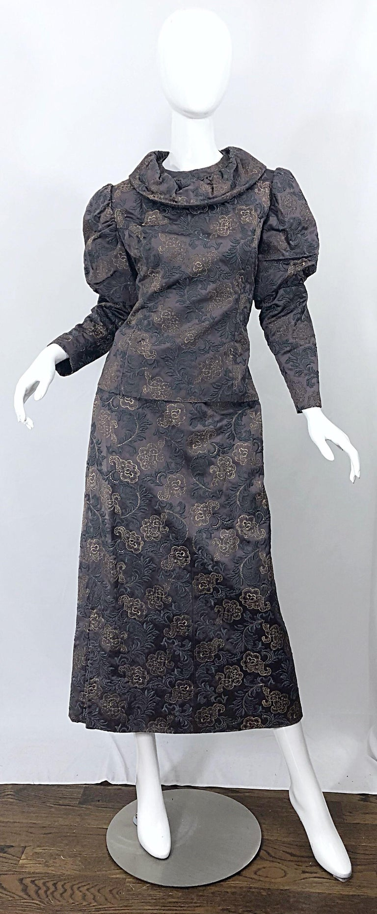 Beautiful 1970s does Victorian era silk brocade taupe and gray maxi skirt and blouse! Top features full metal zipper in the back with hook-and-eye closure. There is also a hidden metal zipper at the side. Chic puff sleeves with a disc collar. Skirt