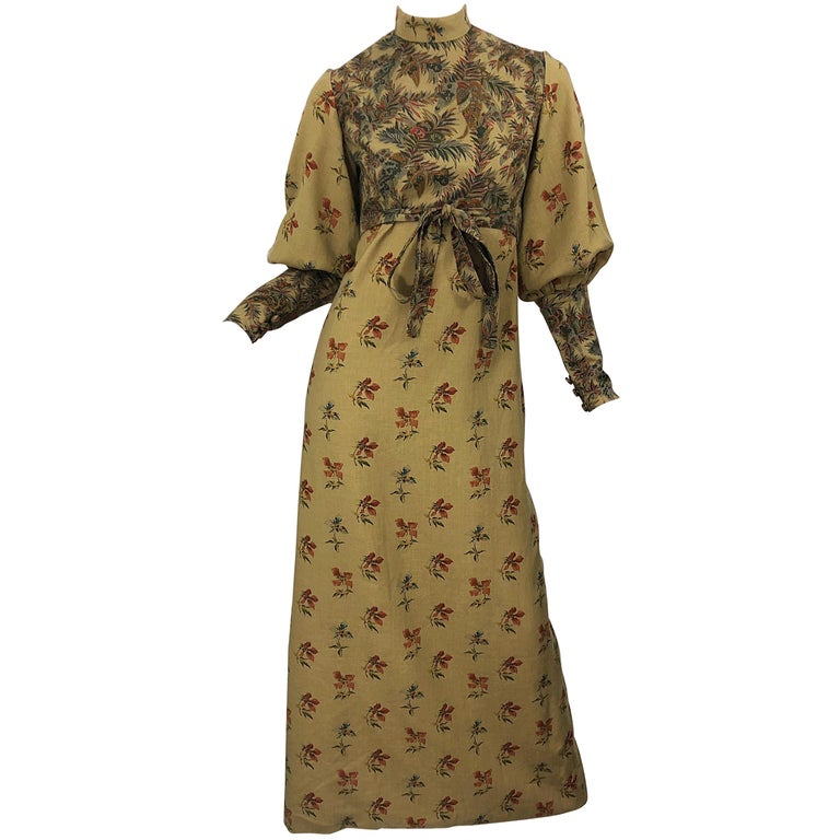 Beautiful 1970s Victorian inspired Autumnal lightweight wool challis long sleeve maxi dress ! Features warm tone of khaki, brown, red, burgundy, green and orange. Printed flowers and leaves throughout. High neck with bishop sleeves. Hidden zipper up