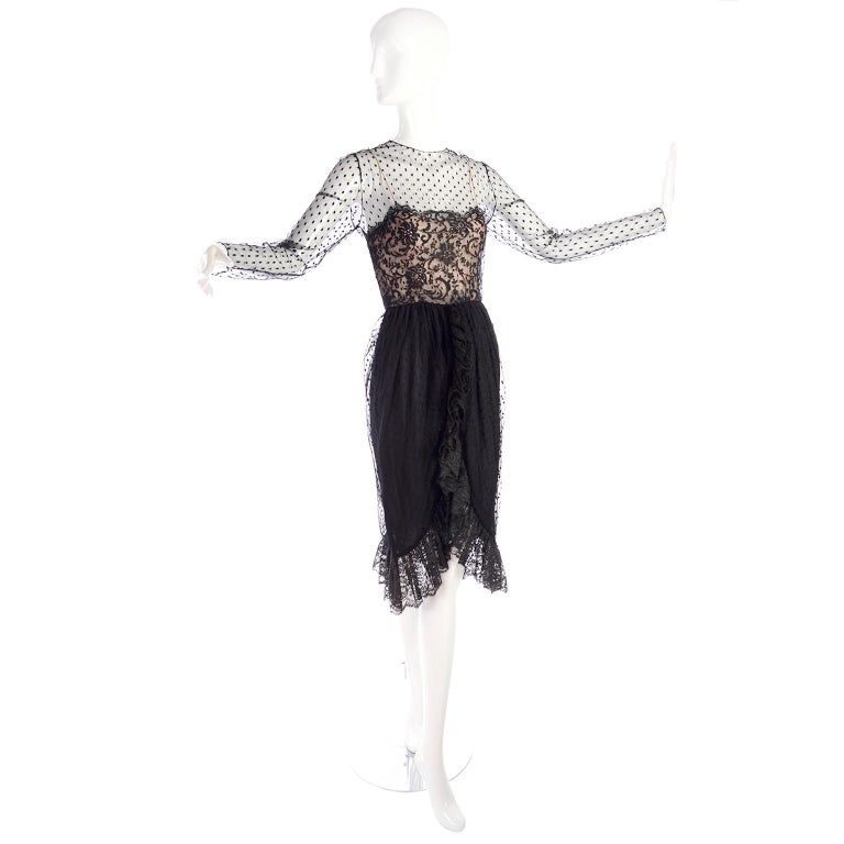 We love this dress! This 1970's Bill Blass vintage black dress is made in a dotted net with lace and nude silk at the bodice. The dress has a hemline that is similar to a tulip hem edged with a ruffle. The dress closes with a button at the neck and