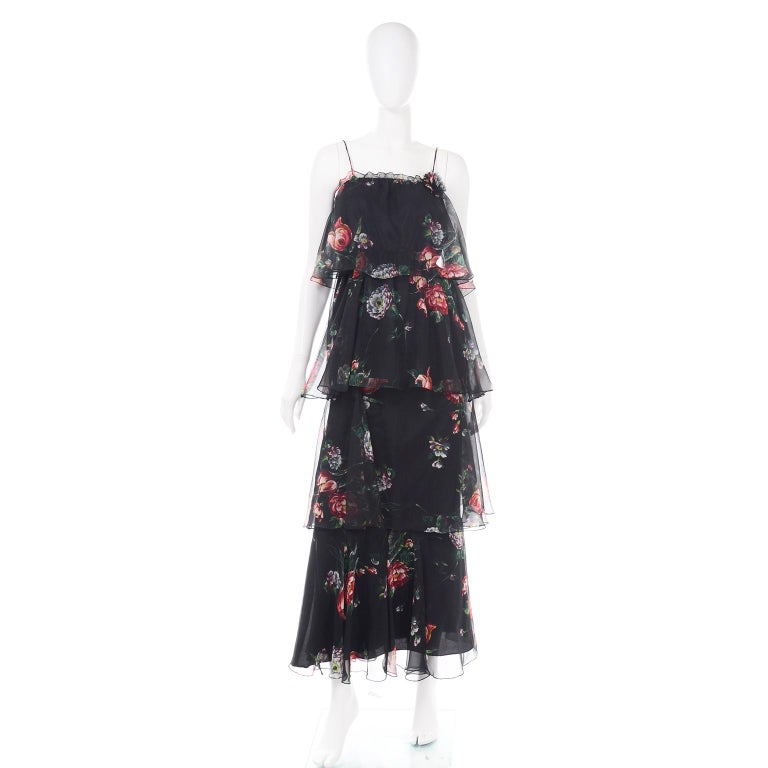 This is a vintage  1970's two piece sheer dress with tiers and ruffles! It has three tiers on top, and the hem tier is connected to a black slip that is separate from the top dress. The dress can be worn as a mini dress, with the last sheer tier