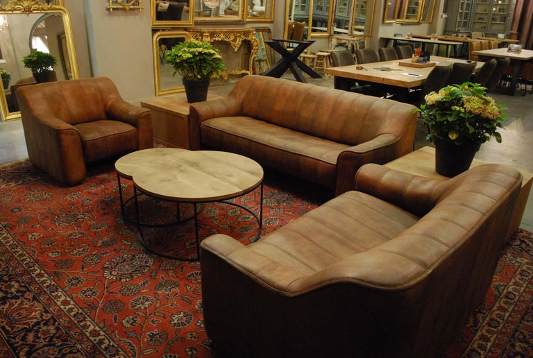 A beautiful Leather block style sofa set in walnut color with beautiful patina and vertical stitching, produced by De Sede, model 44. The softened edges and aged leather reference the organic and naturalist trend was seen in midcentury design. The