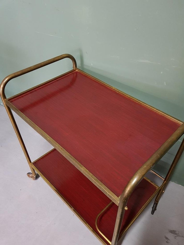 Vintage French serving cart or trolley with brass frame and formica trays and at the bottom there is a bracket to use bottles, it is in good condition with light user marks. Originating from the 1970s.