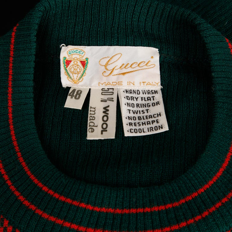 Rare 1970s vintage Gucci golf sweater in green and red from the estate of Pamela Lewis (Jerry Lewis/ Gary Lewis). Novelty design featuring checkers and golfers. Unlined with no closure (pulls on over the head). Fabric content is 50% wool 50%
