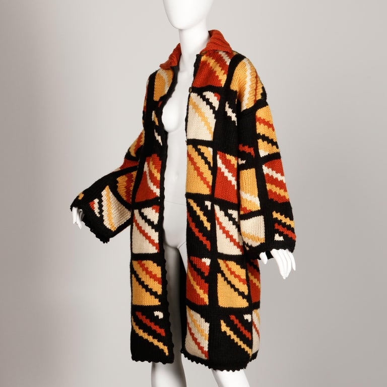 Vibrant handmade chunky knit sweater coat with a diagonal striped window pane design. Fully lined with front button closure. Fits like a modern size large-extra large. The bust measures 44