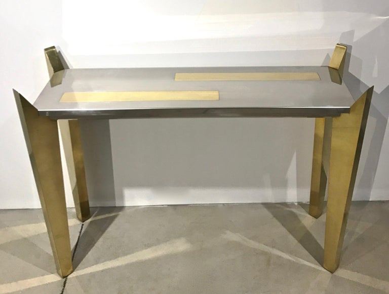 One of a kind 1970s Italian console by L'Angolo Metallarte, Rome, a rare find entirely handmade with wooden structure, unique and innovative sophisticated design: the four legs are hand covered in brass and come up in a slanted shape to embrace the