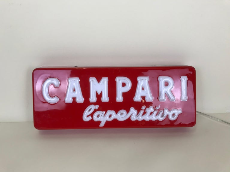 Campari l'aperitivo 'Campari the aperitif' illuminated sign with relief letters produced in Italy in early 1970s. This very rare sign it was displayed inside a selected numbers of Italian bar.  The back of the sign is not original: is now covered