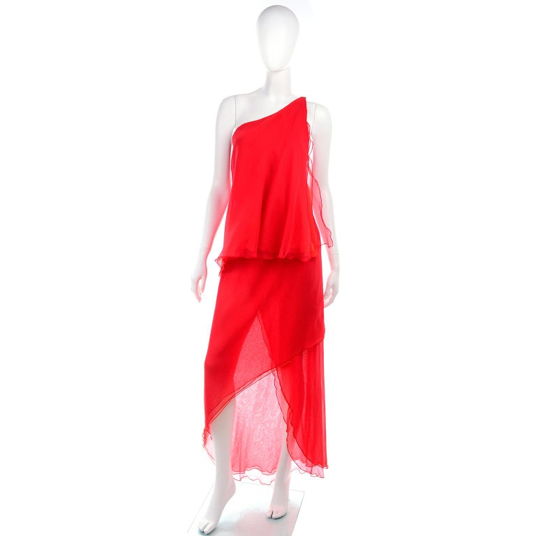 This is a really fun tomato red tiered vintage dress designed by Victor Costa in the 1970's.. The dress has one shoulder styling and the skirt is sheer. The body of this poly chiffon dress is one piece of fabric that wraps around body so the waist