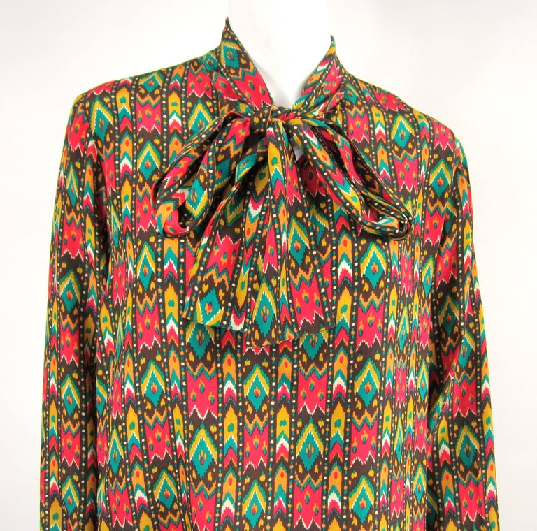 Has a bit of a southwestern vibe! YSL silk 1970s Blouse- Measuring Up to 40 Bust -- Up to 40 waist-- 25 long -- 23.5 sleeve, buttoned cuff. This is out of a massive collection of Contemporary designer clothing as well as Hopi, Zuni, Navajo,