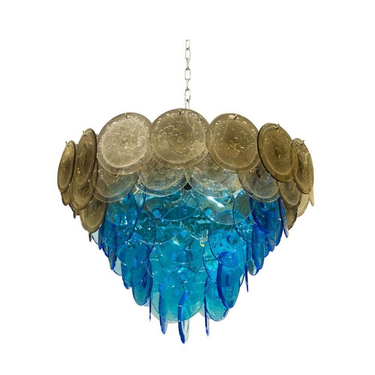 A very attractive Vistosi Disc ceiling light, blown Murano glass disk shaped components Aqua Blue and Bullicante Technique on a chromed steel structure. 10 light bulbs. Adjustable height, Italian design by Vistosi. This colors combination is very