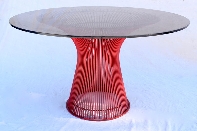 Warren Platner, Knoll dining table in red enamel and steel base, custom ordered by the original owner in the late 1970s. Unusual and original chocolate brown glass top.