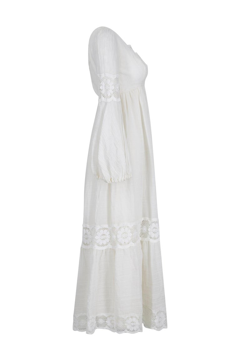 This enchanting 1970s original vintage white cotton boho wedding dress is in impeccable vintage condition and it's romantic, fairytale aesthetic would make a truly captivating bridal gown. The nature of the fine, cotton muslin of the dress adds to