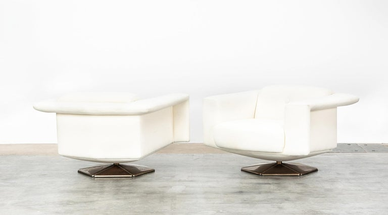 Voitto Happalainen, pair of lounge chairs, zinc-plated steel, Finland, 1972.  Gorgeous lounge chairs by Finish Desinger Voitto Haapalainen. The opulent shape promises comfortable sitting and the appearance of the two pieces an eye-catcher in any