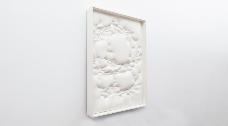 Wall object, foam, paint, signed by Ferdinand Spindel, Germany, 1973.  White wall object by famous artist Ferdinand Spindel comes in a white painted wooden frame. The artwork is signed at the back. The monochrome wall object characterizes his way of