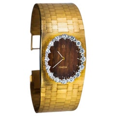1970s Wide Omega Diamond Teak Wood Dial 18 Karat Yellow Gold Bangle Cuff Watch