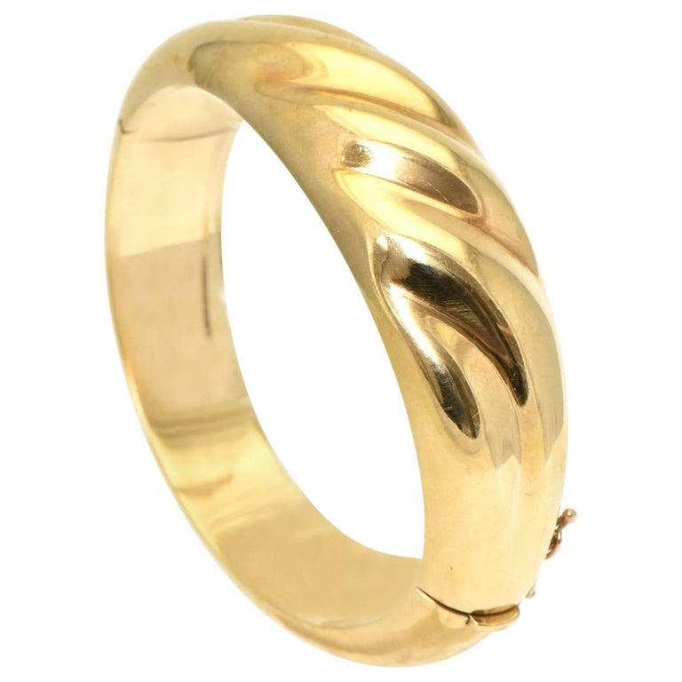 1970s Wide Yellow Gold Wave Bangle Bracelet For Sale