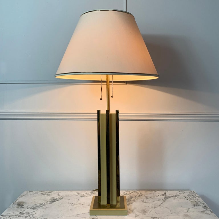 Willy Rizzo attributed table lamp, 1970s, Italy The lamp has 2 E27 screw in bulb holders each with pull chain on/off independently Soft caramel and brass This is a heavy, quality lamp 75cm height, 14cm base width, shade 40cm width Some areas of
