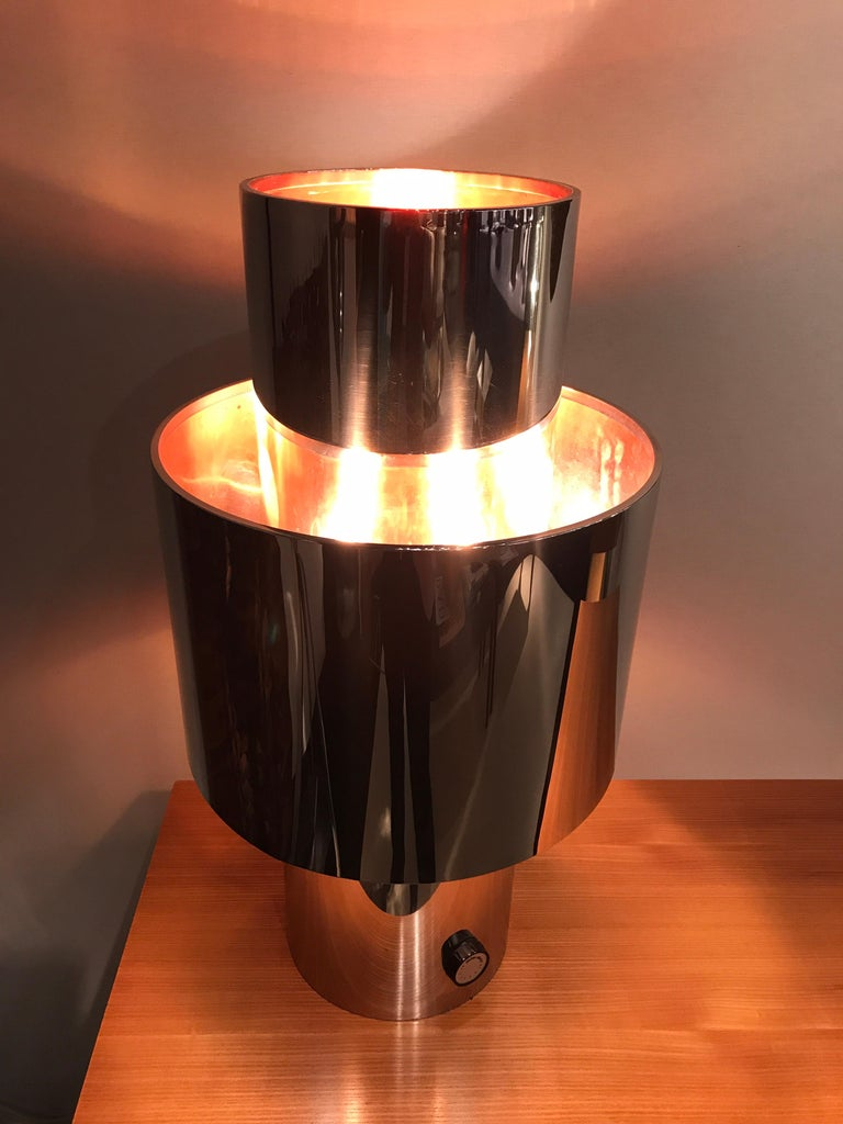 1970s chrome table lamp. Designed By Willy Rizzo Shade interior is on cooper. Good vintage condition  Off/On dimes on working condition. Lamp signed on the side.