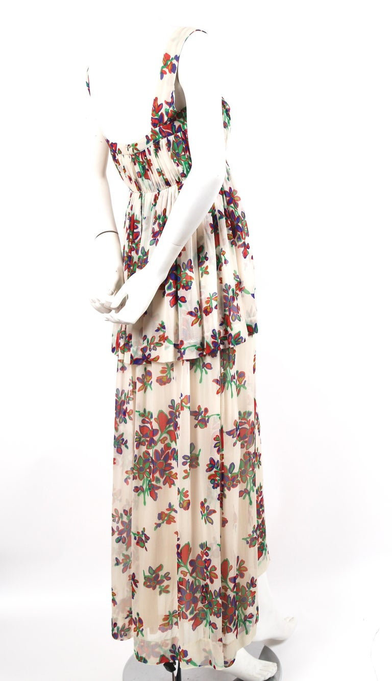 Delicate, floral printed, silk chiffon summer dress designed by Yves Saint Laurent dating to the 1970s. Best fits a size 4 or 6. Approximate measurements: bust 32-33