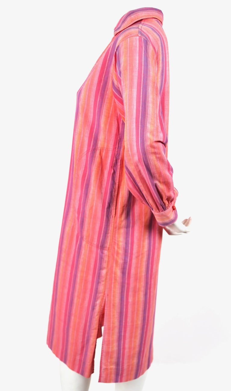 Brightly-colored, fuchsia, orange and purple striped cotton dress designed by Yves Saint Laurent dating to the 1970's. French size 40. Approximate measurements: shoulders 16.75