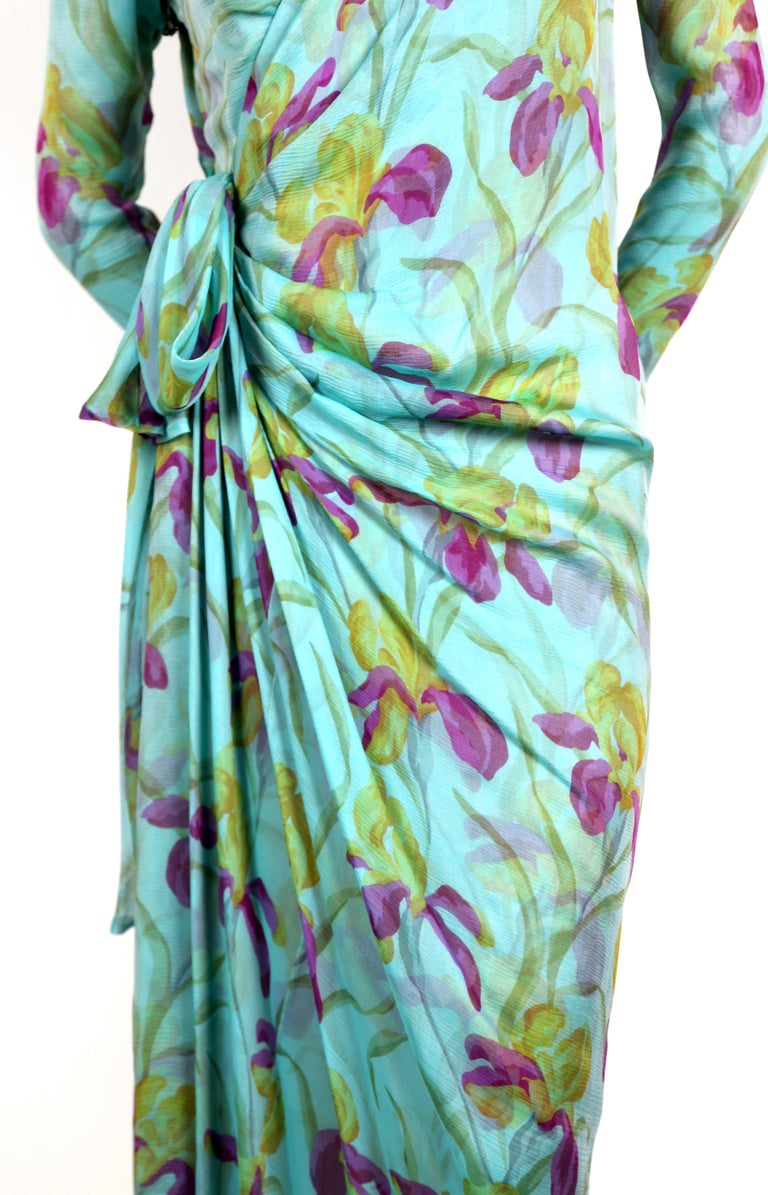 Very rare floral printed silk mousseline haute couture dress designed by Yves Saint Laurent dating to the late 1970's. Dress best fits a size 6. Approximate measurements: shoulders 15