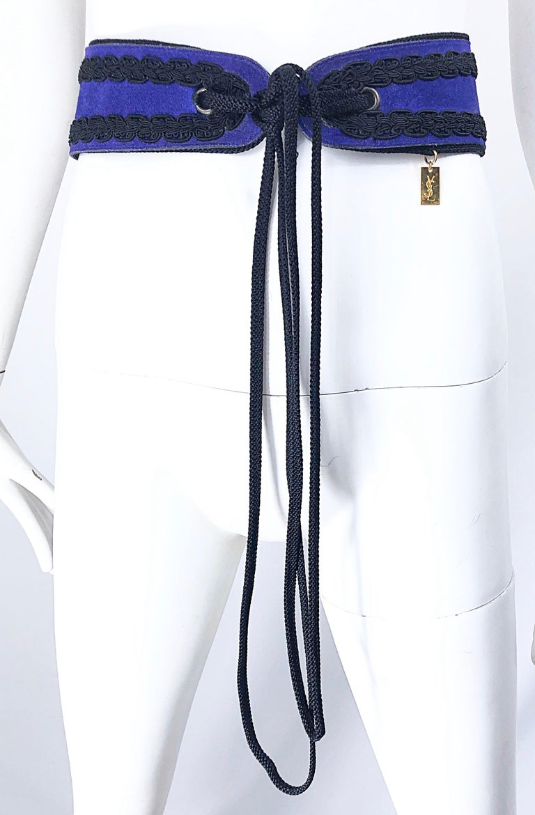 Rare 1970s YVES SAINT LAURENT ( from the famed 1976 YSL Russian Collection ) purple suede leather and black embroidered silk trim. Black ties in the front can adjust to fit an array of sizes. Gold YSL embossed metal plaque at side waist. Makes any