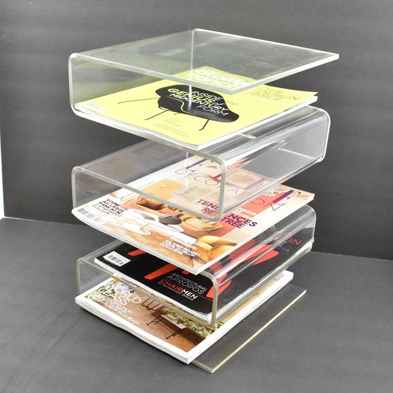 Incredible French 1970s Lucite or acrylic magazine rack, stand, holder. Totally versatile use either in horizontal or upright position. Can also be used as a desk accessory letter holder. Large thick plexiglass construction with wavy zig zag shape.