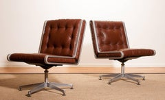 1970s, A Pair of Leather and Aluminium Swivel Chairs