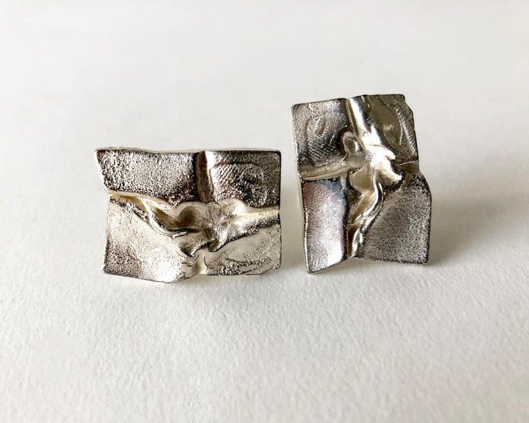 Sterling silver cufflinks created by Master sculptor and jeweler Bjorn Weckstrom of Finland.  Cufflinks are signed with the Lapponia hallmark, S7 (1971), Sterling, Finland, BW.  Suitable for a man or woman.  In very good vintage condition.