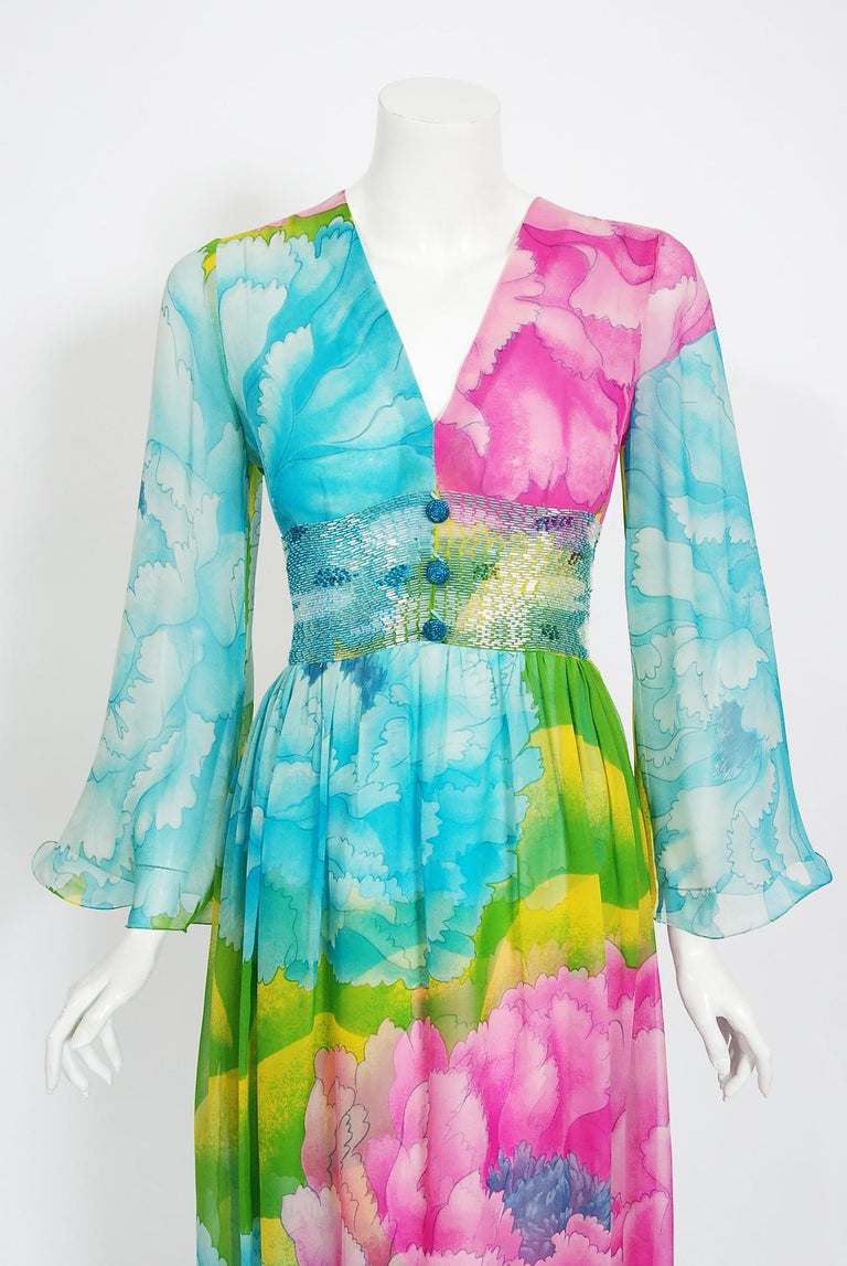 Breathtaking 1972 museum quality large scale floral print silk-chiffon dress by Hanae Mori. Whilst on a Paris holiday in 1960, Mori had a fateful fitting with Coco Chanel. She claimed this meeting changed her life and she challenged herself to