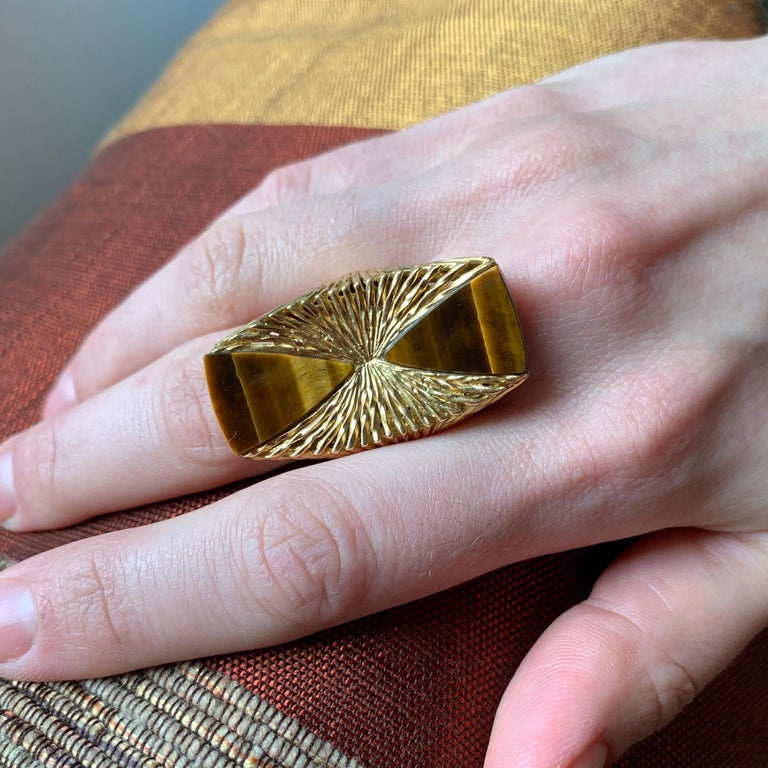 A tiger's eye and textured 18 karat gold ring, by Kutchinsky, 1972.   The ring is size 9. Signed Kutchinsky, makers mark K LD and has London Hallmarks dated with the letter