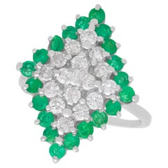 1975 Emerald and 1.36 Carat Diamond White Gold Cocktail Ring