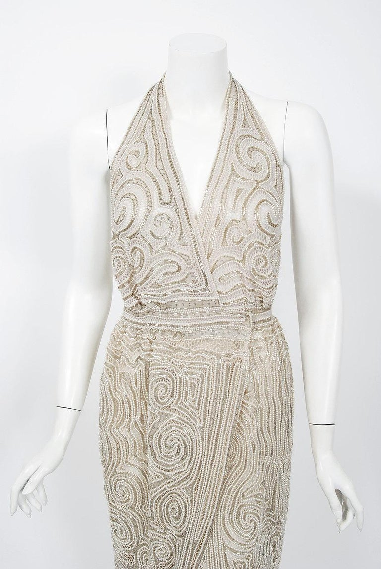 Gorgeous Halston Couture beaded wrap gown dating back to the mid 1970's. Halston revolutionized the way women dress and is one of the few designers, alongside Claire McCardell and Norman Norell, to define what is American fashion. Throughout most of