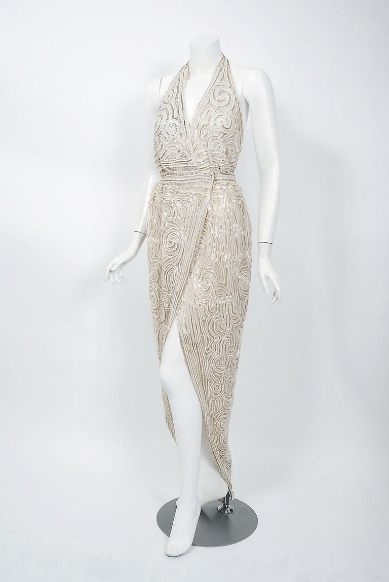 Women's 1975 Halston Couture Ivory Pearl Beaded Swirl Silk Halter Backless Wrap Gown For Sale
