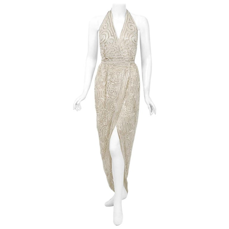 1975 Halston Couture Ivory Pearl Beaded Swirl Silk Halter Backless Wrap Gown For Sale
