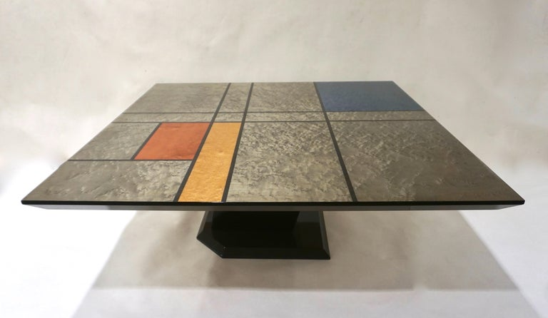 One of a kind Postmodern coffee table, only one example specifically created by Studio Cattaneo for the 1976 Salone del Mobile in Milan, high quality of craftsmanship, with a Mondrian decor lacquered top in royal blue, silver grey, orange yellow