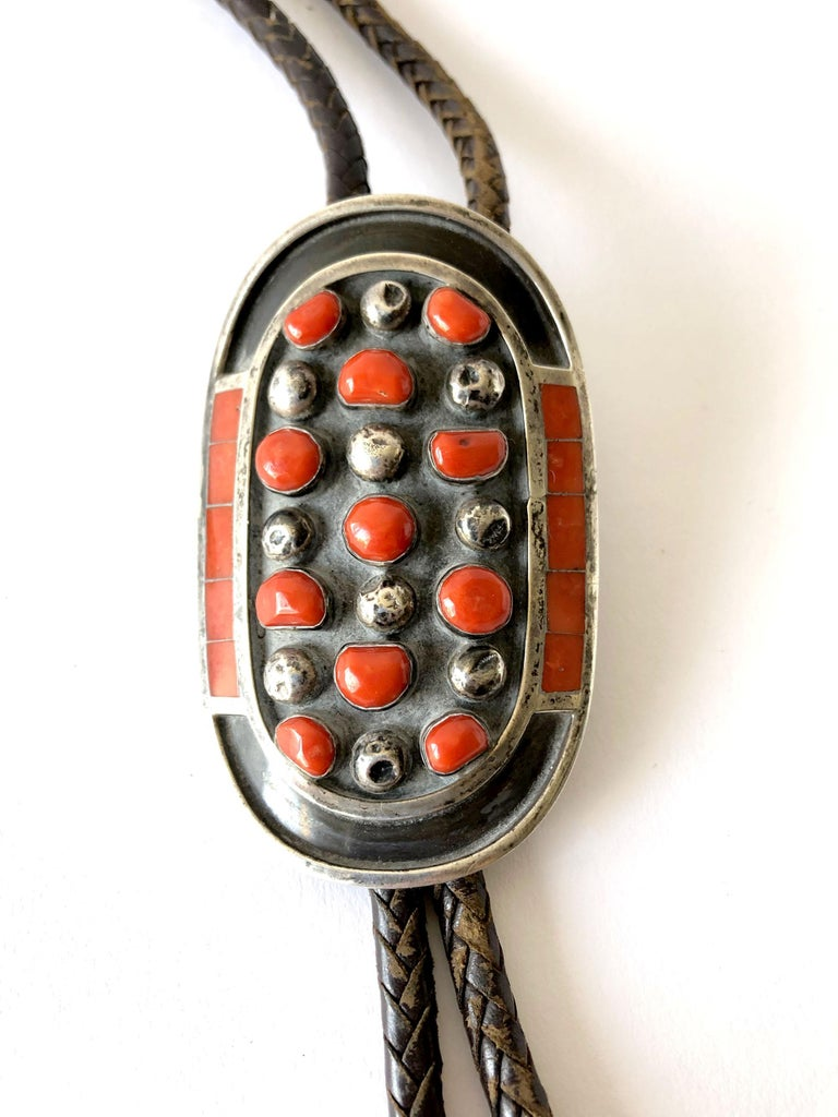 Zuni sterling silver with set with red coral stones and inlaid mosaic bolo tie created by Jobeth D. Mayes.  Bolo measures 3