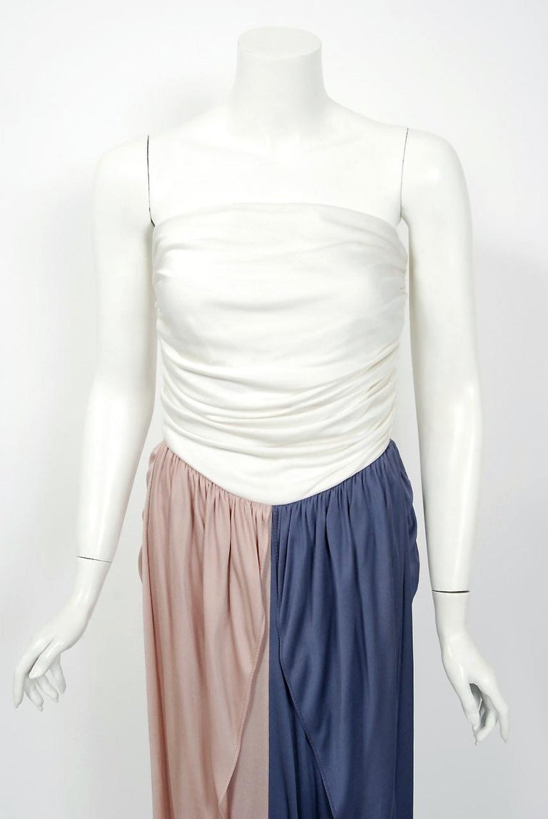Gorgeous Bill Blass ivory, blush and blue tri-color maxi dress dating back to his 1978 collection. Building upon the innovations of European designers such as Coco Chanel, Blass made clothes that allowed women a modern sense of ease. He made