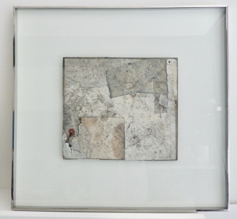 A collage by the American artist Robert Nickle (1919-1980). Nickle studied with Laszlo Maholy-Nagy at the Institute of Design in Chicago where he later taught. Nickle is a regarded as master collage artist. Using street scraps he created timeless,