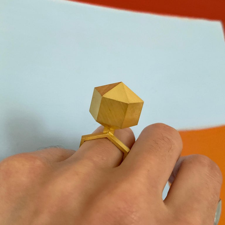 An 18 karat brushed gold geometric ring, by Peter Skubic, 1978.  Size 6.25.  Signed Skubic 78. Stamped with maker's mark, Austrian hallmarks.