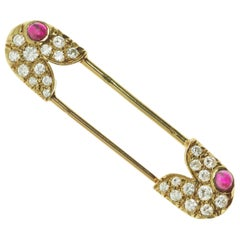 1978 Van Cleef & Arpels Diamond, Ruby and Gold Safety Pin