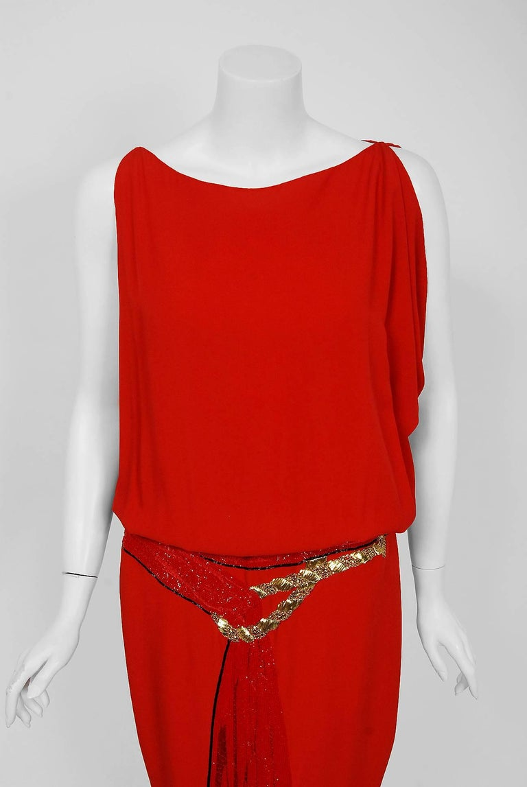 Gorgeous Bill Blass red silk-crepe beaded trompe l'oeil sash dress dating back to his 1979 collection. Building upon the innovations of European designers such as Coco Chanel, Blass made clothes that allowed women a modern sense of ease. He made