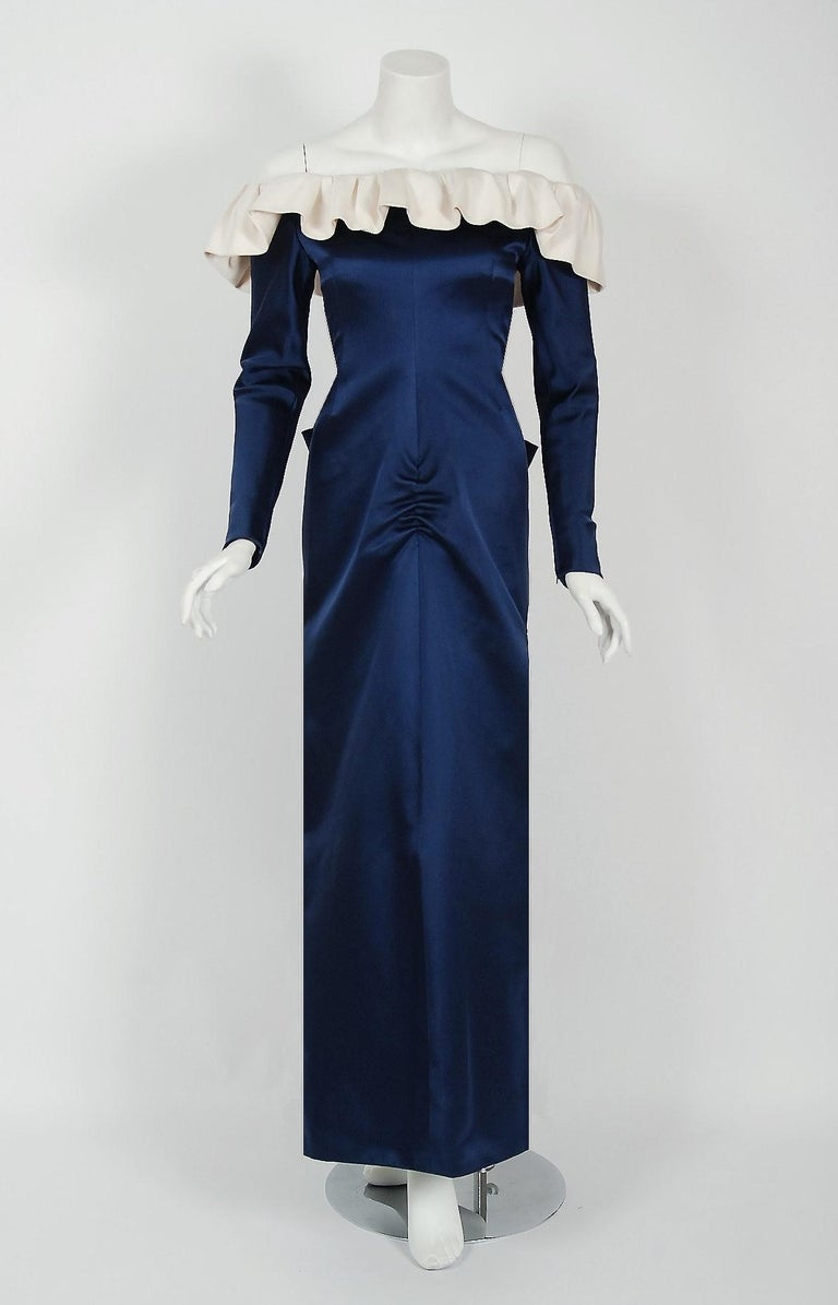 Givenchy, the name itself evokes glamour, refined elegance, simplicity and style. Givenchy's trademark of sculpted lines and luxurious fabrics make his work easily recognizable. This gorgeous gown, dating back to his 1979 collection, is a beautiful